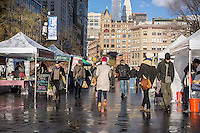 The relatively quiet winter Union Square Greenmarket in New York on Friday, January 9, 2015.   (© Richard B. Levine)
