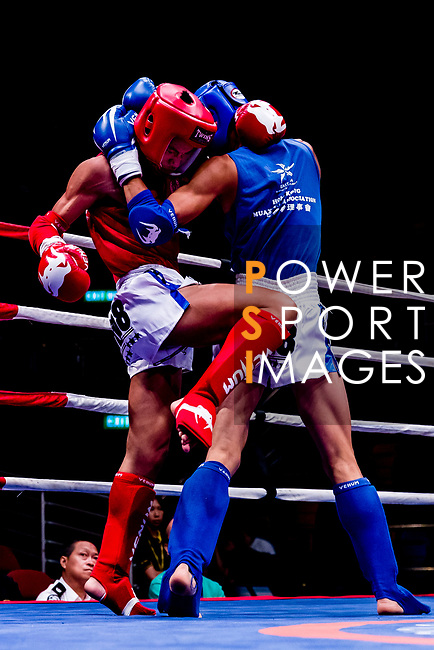 Xiao Feng (Red) of China fights against Chen Yu Xi (Blue) of Taiwan in the male muay 54KG division weight bout during the East Asian Muaythai Championships 2017 at the Queen Elizabeth Stadium on 11 August 2017, in Hong Kong, China. Photo by Yu Chun Christopher Wong / Power Sport Images