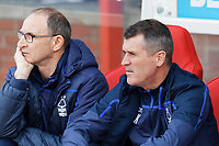 (L-R) Nottingham Forest manager Martin O'Neill and coach Roy Keene sit in the dug out during the Sky Bet Championship match between Nottingham Forest and Swansea City at City Ground, Nottingham, England, UK. Saturday 30 March 2019