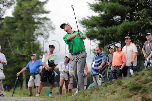 02.09.2013. Boston, Mass, USA.  Charley Hoffman hits from the cart path on 2 during the Final Round of the Deutsche Bank Championship at TPC Boston, Norton, MA on September 2, 2013.