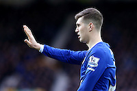 John Stones holds up his hand by way of an apology during the Barclays Premier League match between Everton and Swansea City played at Goodison Park, Liverpool
