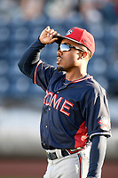 Blue sky and fluffy clouds are reflected in the sunglasses of right fielder Justin Dean (5) of the Rome Braves as he prepares for a game against the Greenville Drive on April 19, 2019, at Fluor Field at the West End in Greenville, South Carolina. (Tom Priddy/Four Seam Images)