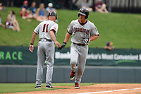 Designated hitter Alex Kowalczyk (22) of the Hickory Crawdads is congratulated by manager Spike Owen (11) after hitting a home run in a game against the Greenville Drive on Sunday, July 16, 2017, at Fluor Field at the West End in Greenville, South Carolina. Hickory won, 3-1. (Tom Priddy/Four Seam Images)