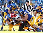 BROOKINGS, SD - OCTOBER 25:  A host of defenders including Jesse Bobbit #7, TJ Lalley #33, and Cole Langer #54 from South Dakota State University bring down Martin Ruiz #29 from Youngstown State in the fourth quarter of their game Saturday afternoon at Coughlin Alumni Stadium in Brookings. (Photo by Dave Eggen/Inertia)