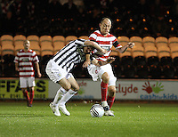 Lewis Guy tackled by Alex Neil in the St Mirren v Hamilton Academical Scottish Communities League Cup match played at St Mirren Park, Paisley on 25.9.12.