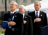 Donald Rumsfeld, former U.S. Secretary of Defense, left, Robert Gates, U.S. Secretary of Defense, center, and U.S. President George W. Bush recite the Pledge of Allegiance during the dedication of the September 11th Memorial at the Pentagon on the 7th anniversary of the September 11, 2001 attacks on New York and Washington in Washington, DC, Thursday, September 11, 2008.  <br /> Credit: Joshua Roberts / Pool via CNP