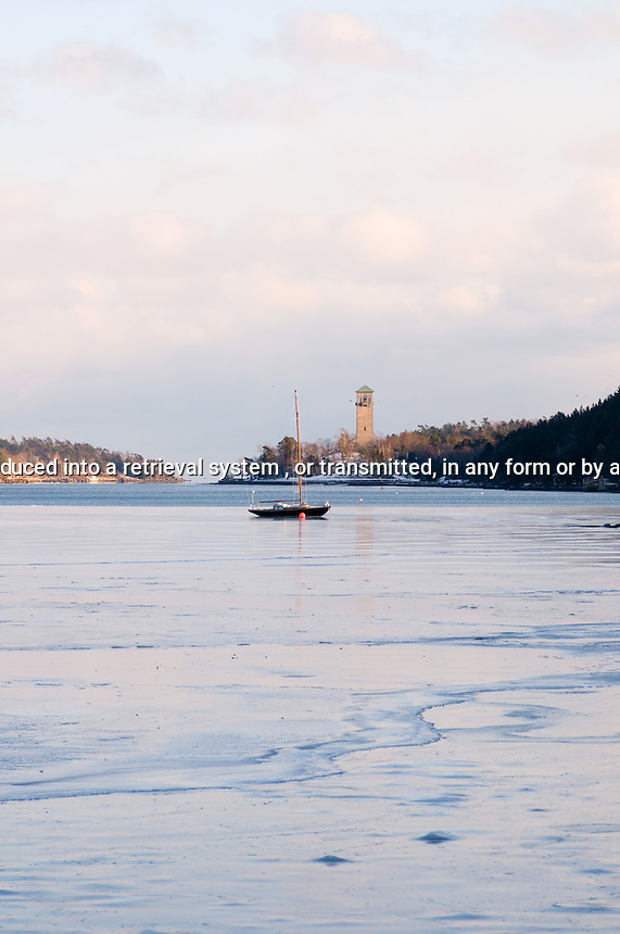 Sail boat in the Northwest Arm surrounded by ice, Halifax Nova Scotia Canada North America
