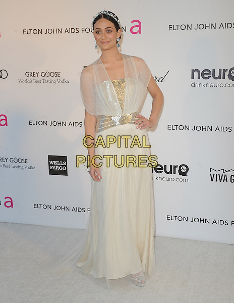 Emmy Rossum.The 21st Annual Elton John AIDS Foundation Academy Awards Viewing Party held at The City of West Hollywood Park in West Hollywood, California, USA..February 24th, 2013.oscars full length dress hand on hip white sheer blue pearls silver belt hairband                  .CAP/DVS.©DVS/Capital Pictures.