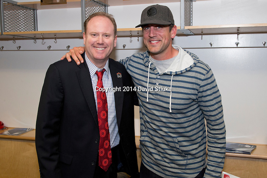Wisconsin Badgers assistant coach Greg Gard with Green Bay Packers quarterback Aaron Rodgers after  a regional semifinal NCAA college basketball tournament game against the Baylor Bears Thursday, March 27, 2014 in Anaheim, California. The Badgers won 69-52. (Photo by David Stluka)