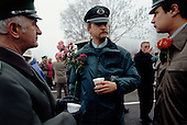 Ostpreu Bendamm, Germany<br /> November 14, 1989 <br /> <br /> East German police with flowers from West Germans chat after the opening of the Berlin Wall. Germans gathered as the wall is dismantled and the East German government lifts travel and emigration restrictions to the West on November 9, 1989.