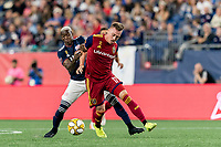 FOXBOROUGH, MA - SEPTEMBER 21: Corey Baird #17 of Real Salt Lake on the attack as Luis Caicedo #27 of New England Revolution defends during a game between Real Salt Lake and New England Revolution at Gillette Stadium on September 21, 2019 in Foxborough, Massachusetts.
