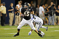 1 October 2011:  FIU tight end Colt Anderson (15) slips away from Duke safety Walt Canty (4) after a reception in the third quarter as the Duke University Blue Devils defeated the FIU Golden Panthers, 31-27, at FIU Stadium in Miami, Florida.