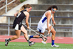 Torrance, CA 05/09/13 - Jackie Adelsberg (Agoura #12) and Taylor Martino (Oak Park #3) in action during the 2013 Los Angeles area Girls Varsity Lacrosse Championship.  Agoura defeated Oak Park 13-7.