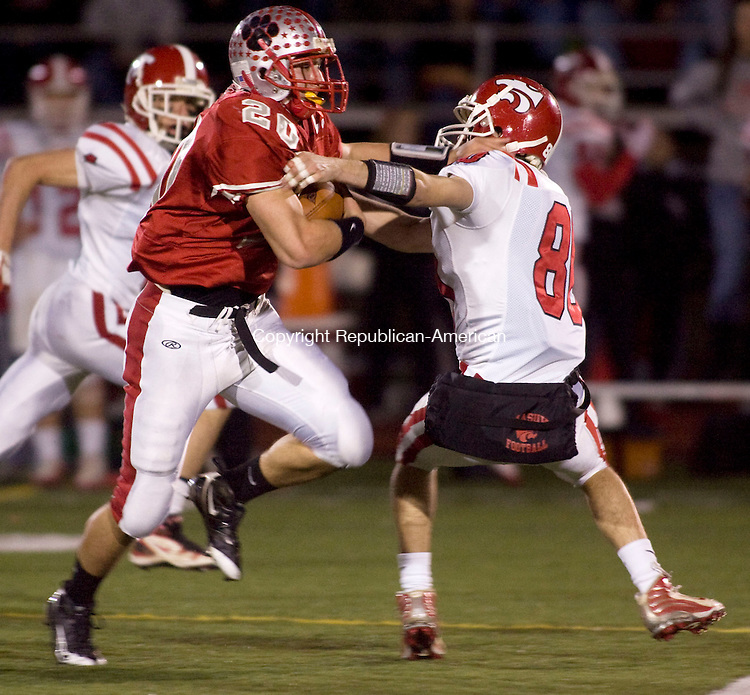 SOUTHBURY, CT - 19 NOVEMBER 2009 -111909JT11-<br /> Pomperaug's Ben Crick dodges an attempted tackle from Masuk's Joe Diaz during Thursday's Southwest Conference Football Championship at Pomperaug.<br /> Josalee Thrift Republican-American