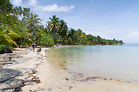 Tourists walk the beach at Boca del Drago, near Star Beach, Colon Island, Panama