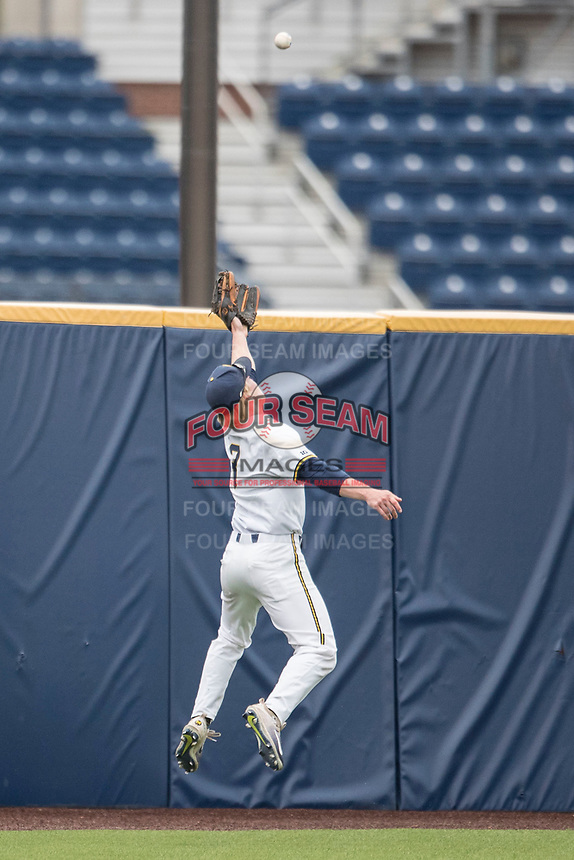 Michigan Wolverines outfielder Miles Lewis (3) attempts to catch a ball over his head in the outfield against the Michigan State Spartans on May 19, 2017 at Ray Fisher Stadium in Ann Arbor, Michigan. Michigan defeated Michigan State 11-6. (Andrew Woolley/Four Seam Images)