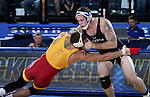 BROOKINGS, SD - NOVEMBER 4:  Nate Rotert from South Dakota State battles with Patrick Downey from Iowa State in their 197 pound match Friday evening at Frost Arena in Brookings. (Photo by Dave Eggen/Inertia)