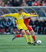02 May 2009: Columbus Crew midfielder/forward Robbie Rogers #19 and Toronto FC midfielder Sam Cronin #2 in action at BMO Field in a game between the Columbus Crew and Toronto FC. .The game ended in a 1-1 draw...