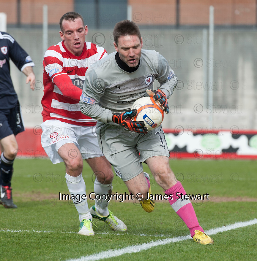 Raith goalkeeper David McGurn seems to carry the ball out of the park but the ref waves play on.
