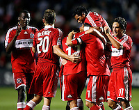 Chicago Fire players Bakary Soumare (4, left), Brian McBride (20), Logan Pause (7), Diego Gutierrez (8, on top), and John Thorrington (11) congratulate midfielder Stephen King (33) after King scored the game's only goal.  The Chicago Fire defeated the New York Red Bulls 1-0 at Toyota Park in Bridgeview, IL on September 6, 2008.
