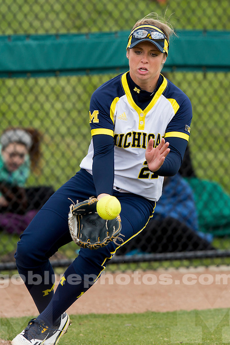 Michigan's Kelly Christner (21) fields a ball in the outfield during an NCAA college softball game on Saturday, April 2, 2016, in Bloomington, Indiana. (Photo by James Brosher)