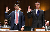 """Mark W. Begor, Chief Executive Officer, Equifax, Inc., left, and Arne M. Sorenson, President and Chief Executive Officer, Marriott International, Inc., are sworn-in to testify before the United States Senate Committee on Homeland Security and Governmental Affairs Permanent Subcommittee on Investigations during a hearing on """"Examining Private Sector Data Breaches"""" on Capitol Hill in Washington, DC on Thursday, March 7, 2019.<br /> Credit: Ron Sachs / CNP"""