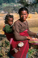 Close up of mother and baby on her back near Mt Everest in remote country of Nepal