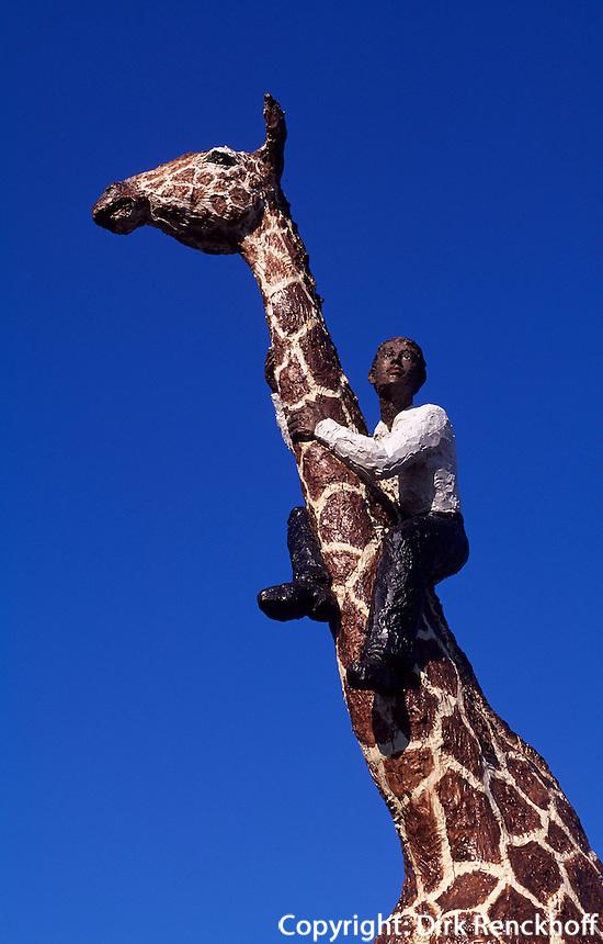 Mann auf Giraffe von Stephan Balkenhol vor Hagenbeck's Tierpark, Hamburg, Deutschland