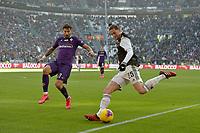 2nd February 2020; Allianz Stadium, Turin, Italy; Serie A Football, Juventus versus Fiorentina; Federico Ceccherini of Fiorentina challenges Adrien Rabiot of Juventus as he crosses the ball