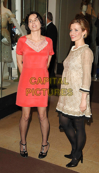 SADIE FROST & GUEST.Evening Standard Theatre Awards, Royal Opera House, London, England. - November 24th, 2008.full length red pink coral dress black fishnet tights t-bar shoes gold lace print pattern beige lace .CAP/DS.©Dudley Smith/Capital Pictures