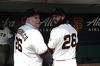 "SAN FRANCISCO, CA - APRIL 8:  John ""The Count"" Montefusco and Cory Gearrin #26 of the San Francisco Giants pose for a picture in the dugout waiting before the game against the Los Angeles Dodgers at AT&T Park on Sunday, April 8, 2018 in San Francisco, California. (Photo by Brad Mangin)"