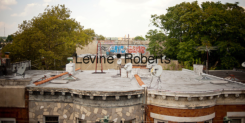 Satellite dishes atop homes in the East New York neighborhood of Brooklyn in New York are seen on Saturday, September 1, 2012. (© Richard B. Levine)
