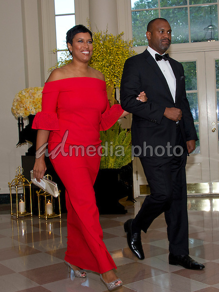 Mayor Muriel Bowser (Democrat of Washington, DC) and <br /> Jason Turner arrive for the State Dinner honoring Prime Minister Lee Hsien Loong of the Republic of Singapore at the White House in Washington, DC on Tuesday, August 2, 2016. Photo Credit: Ron Sachs/CNP/AdMedia