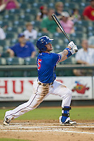 Round Rock Express third baseman Jason Donald (5) follows through on his swing during the Pacific Coast League baseball game against the Omaha Storm Chasers on June 1, 2014 at the Dell Diamond in Round Rock, Texas. The Express defeated the Storm Chasers 11-4. (Andrew Woolley/Four Seam Images)