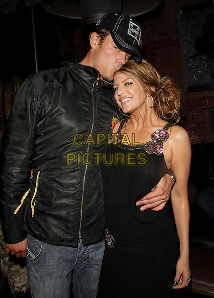 JOSH DUHAMEL & FERGIE.Fergie's Birthday Party at Citizen Smith Nightclub in Hollywood , California, USA..March 28th, 2006.Ref: DVS.Stacey Ferguson Black Eyed Peas half length baseball cap hat couple arm around waist kiss jacket dress.www.capitalpictures.com.sales@capitalpictures.com.Supplied By Capital PIctures.