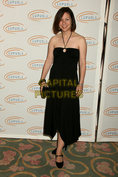 "CATHY CAHLIN RYAN.Lupus LA's ""Love, Light and Laughter"" Fundraiser 2007 at the Beverly Hills Hotel, Beverly Hills, California, USA..May 8th, 2007.full length dress clutch purse black halterneck .CAP/ADM/BP.©Byron Purvis/AdMedia/Capital Pictures"