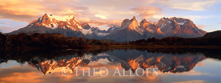 Reflections in Lake Pehoe at sunrise, Paine Grande and Cuernos del Paine; Chile, Torres Del Paine National Park