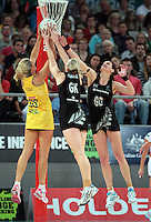 16.09.2012 Silver Ferns Katrina Grant Leana de Bruin and Australian Cathrine Cox in action during the first netball test match between the Silver Ferns and the Australian Diamonds played at the Hisense Arena In Melbourne. Mandatory Photo Credit ©Michael Bradley.