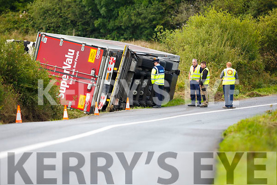 Gardaí at the scene on the main Brosna to Knocknagree Road on Wednesday afternoon after a SuperValu truck left the road earlier in the morning. The truck was due to be removed from the scene using two large cranes on Wednesday evening.