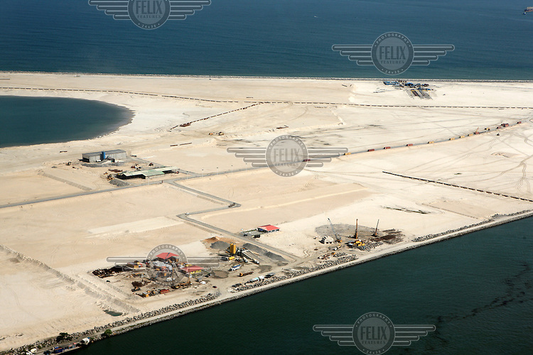 An aerial view of the first stage of an ambitious scheme to reclaim an area of 9000 square metres from the ocean. A wall 1.4 kilometres out to sea has already been constructed and 95 million cubic metres of sand is being pumped into the area between the current ocean front and the new barrier in order to create a new city, Eko Atlantic. This development will contain residential, financial and commercial districts and up to 250,000 people will live there with a further 150,000 commuters arriving each day.