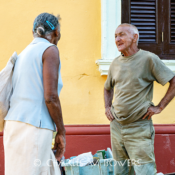 Faces Of Cuba - The banana man talks to a customer.<br />