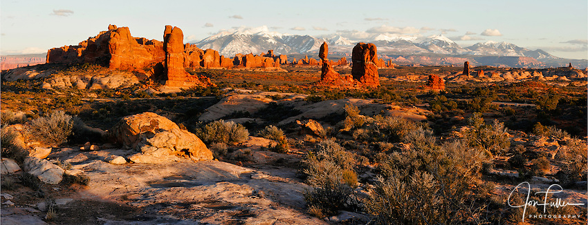 Panoramic image of Balanced Rock  in Arches National Park, near Moab, Utah, USA at sunset with the snow-capped La Sal Mountains in the background.