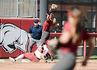 NWA Democrat-Gazette/CHARLIE KAIJO Arkansas Razorbacks third baseman makes a catch as Oklahoma Caleigh Clifton (20) slides to third during a softball match, Sunday, October 28, 2018 at Bogle Park, University of Arkansas in Fayetteville.<br />