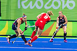 Alyssa Manley #29 of United States depends the pass by Susannah Townsend #9 of Great Britain while Lauren Crandall #27 of United States watches during Great Britain vs USA in a women's Pool B game at the Rio 2016 Olympics at the Olympic Hockey Centre in Rio de Janeiro, Brazil.