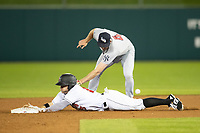 JB Shuck (15) of the Indianapolis Indians slides into second base as Scranton/Wilkes-Barre RailRiders Brad Miller (4) attempts to apply the tag at Victory Field on May 14, 2019 in Indianapolis, Indiana. The Indians defeated the RailRiders 4-2. (Andrew Woolley/Four Seam Images)