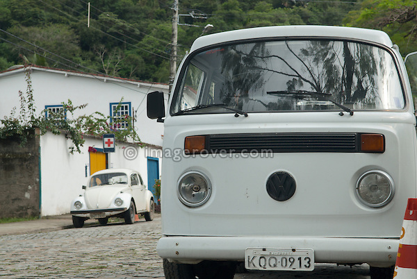 Brasilian built Volkswagen Bus T1.5 and Volkswagen Fusca (VW Beetle). Paraty, Espirito Santo, Brazil. --- No releases available. Automotive trademarks are the property of the trademark holder, authorization may be needed for some uses.