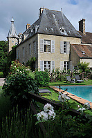 The contemporary outdoor swimming pool is situated on an enclosed stretch of lawn at the rear of the chateau
