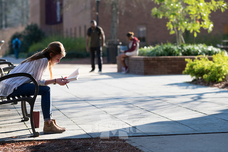 Student Chandler Scarbrough (Accounting major), sitting on bench near Colard Union, reading book for a class assignment.<br />   (photo by Megan Bean / &copy; Mississippi State University)