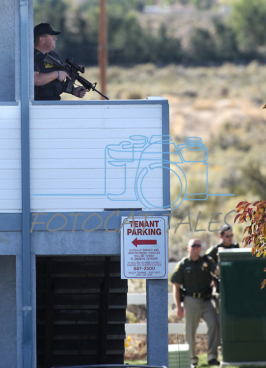 Carson City Sheriff's officers surround an apartment where bank robbery suspect Rachel Darlene Barrett, 30, was holed up Tuesday morning, Oct. 11, 2011 in Carson City, Nev. Barrett was later arrested after allegedly robbing the Carson City Nevada State Bank branch..Photo by Cathleen Allison