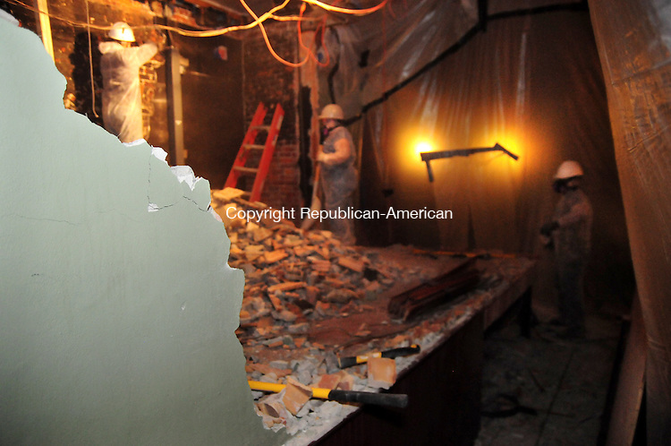 THOMASTON, CT, 14 FEB 14-021413AJ05-  In two days American Vets Abatement has nearly removed an old concrete projection booth from the balcony of the Thomaston Opera House.    Alec Johnson/ Republican-American